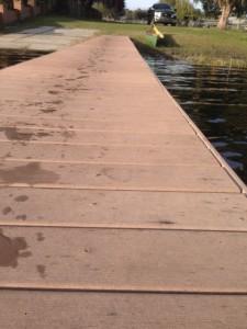 photo of Florida lake dock with footprints