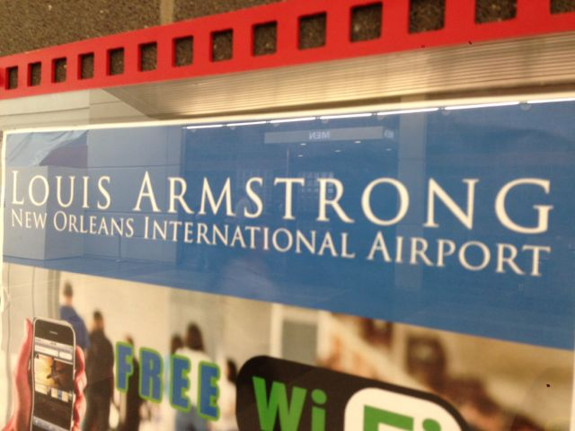 Louis Armstrong New Orleans International airport sign