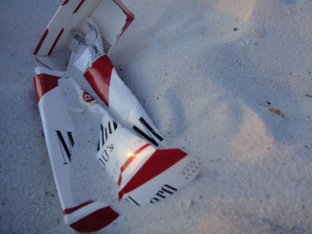 Trashed Marlboro box in the sand