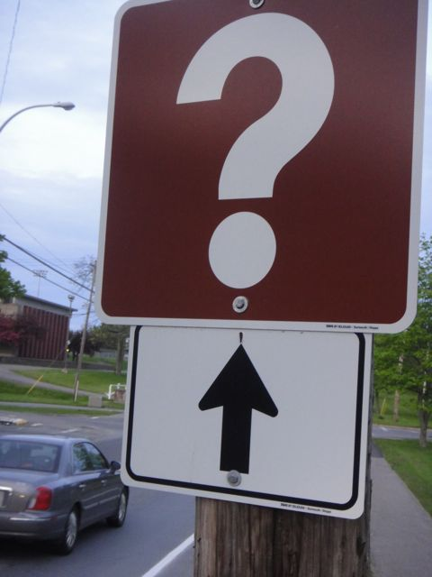 highway information sign, a giant question mark