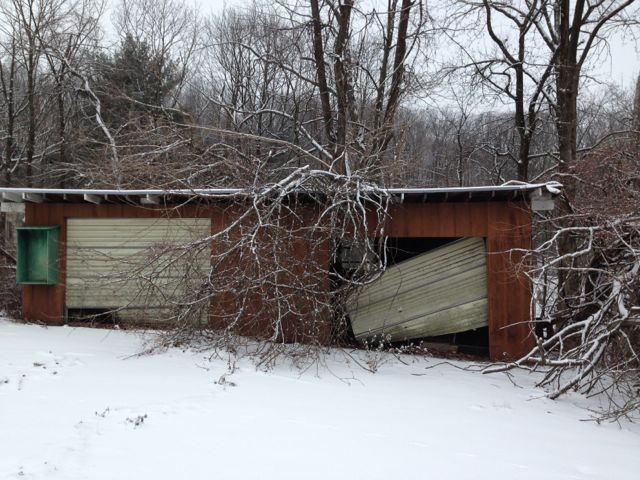 Old, neglected garage in winter