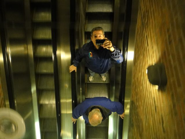 Two colleagues on a Nova Scotia escalator