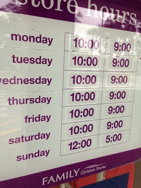 Store hours sign on shop's front door
