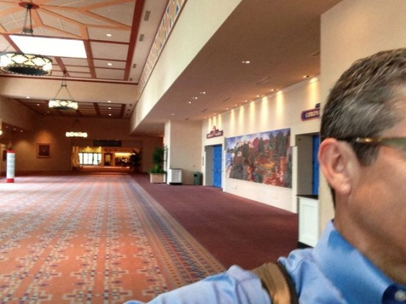 Business man rushing through convention center