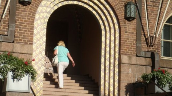Woman climbing stairs on bright Summer morning