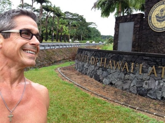 jeff noel in front of University of Hawaii Hilo entrance sign