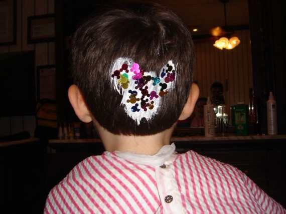 Mickey Mouse design on toddler's hair from Disney haircut on Main Street USA
