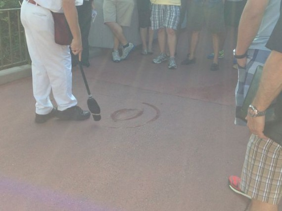 Disney Janitor painting a water Mickey Mouse