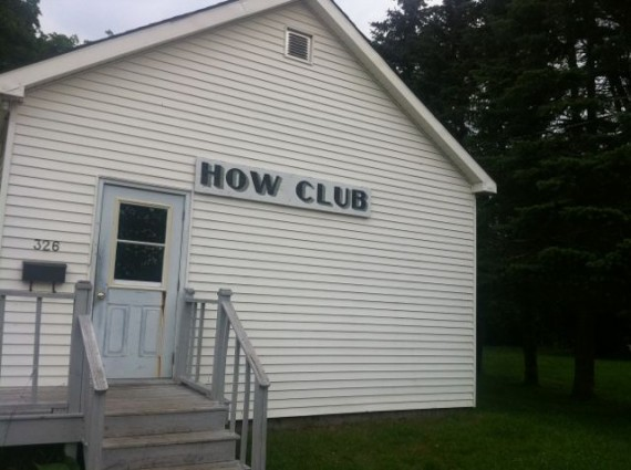 Small white building called How Club