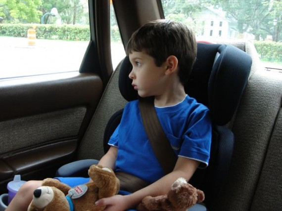 young child in car seat with stuffed animals