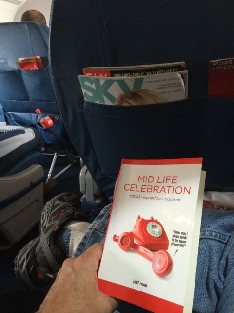 Mid Life Celebration book in Delta first class cabin