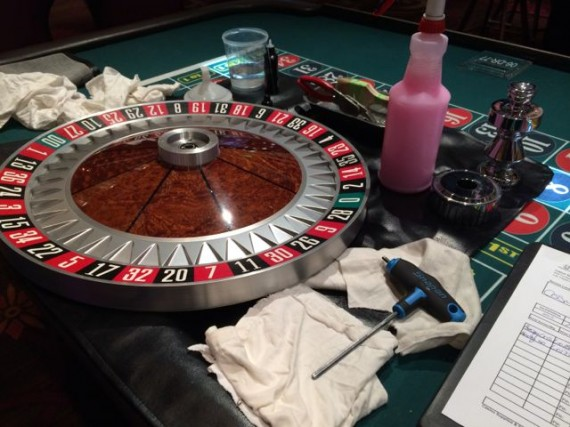 Roulette wheel being cleaned