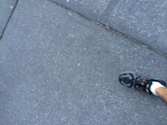 One foot step on NYC sidewalk