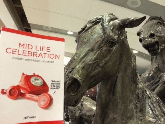 Mid Life Celebration book at Calgary airport horse sculpture