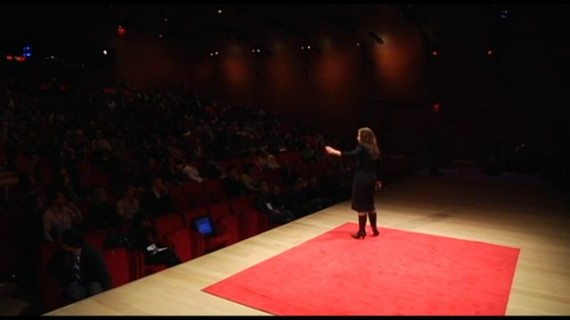TED talk stage with female speaker