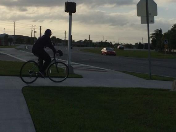 Youth on bicycle near Walt Disney World back entrance