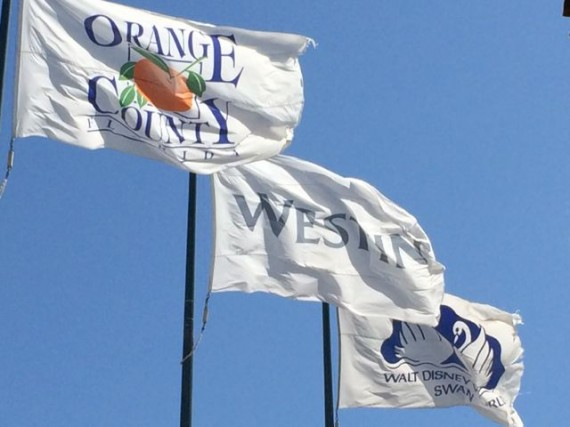 Three Orange County Florida Flags blowing in the wind