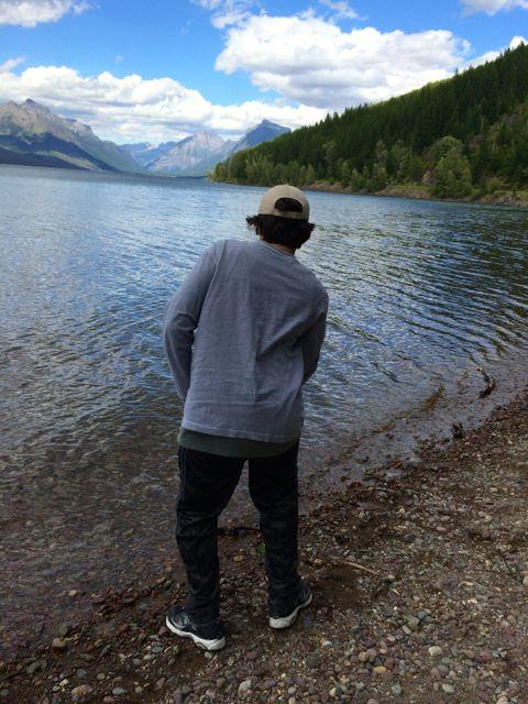 Teen learning to skip a stone at Lake Mcdonald