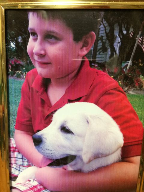 Photo frame of boy and puppy