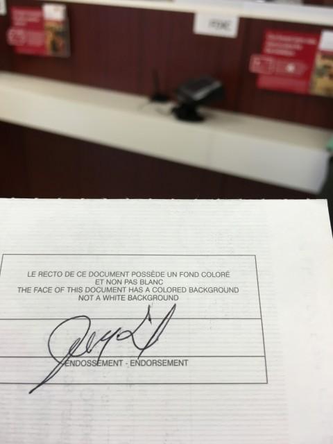Depositing business check at bank.