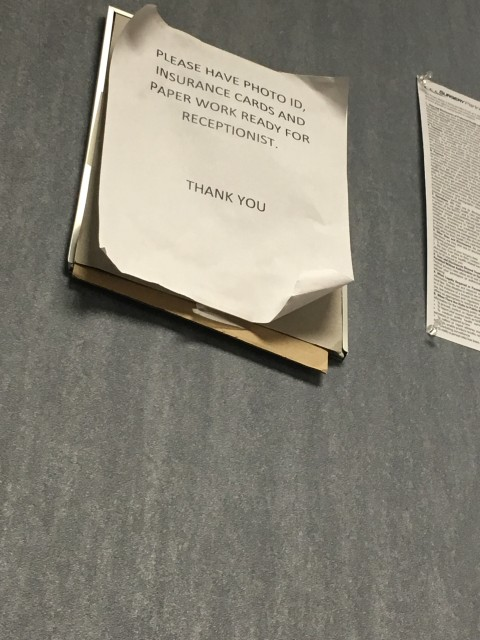 Tattered sign in medical office