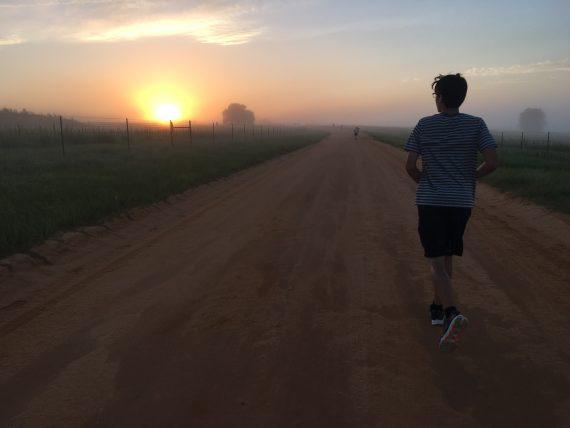 Lone runner at sunrise