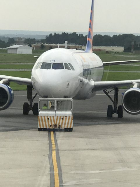 Airline jet being pushed