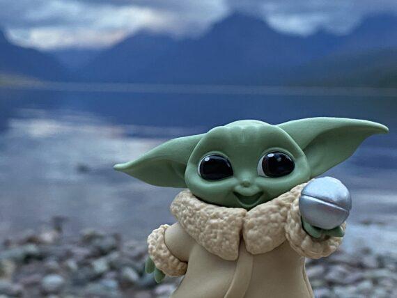 Baby Yoda by mountain lake