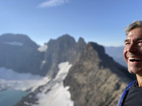 jeff noel laughing in mountain setting