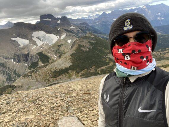 jeff noel on mountain side, wearing a mask