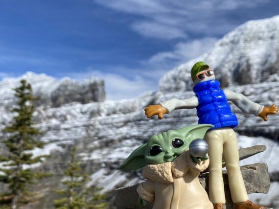 Disney plastic toys in mountain setting