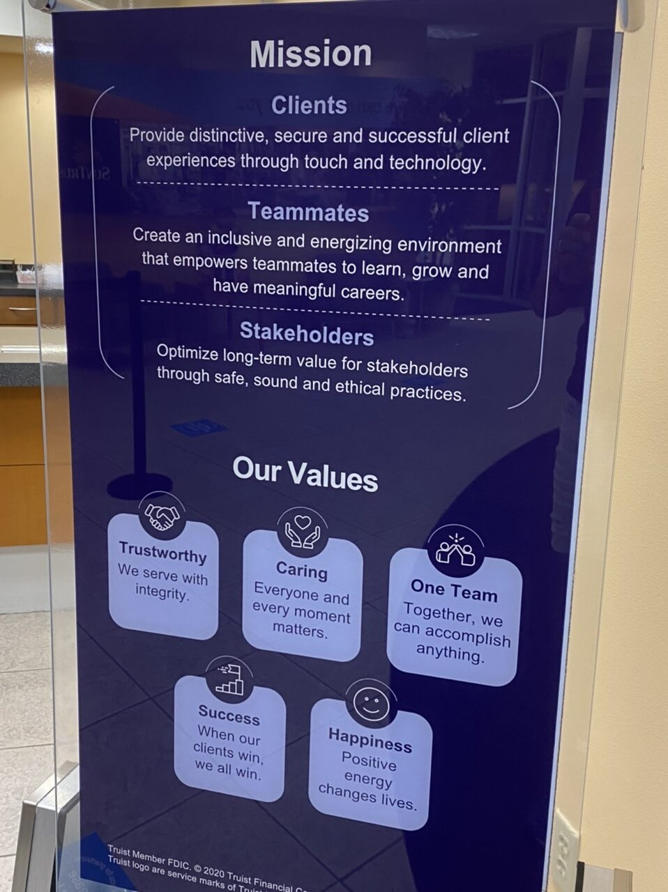 Bank lobby sign with vision and mission