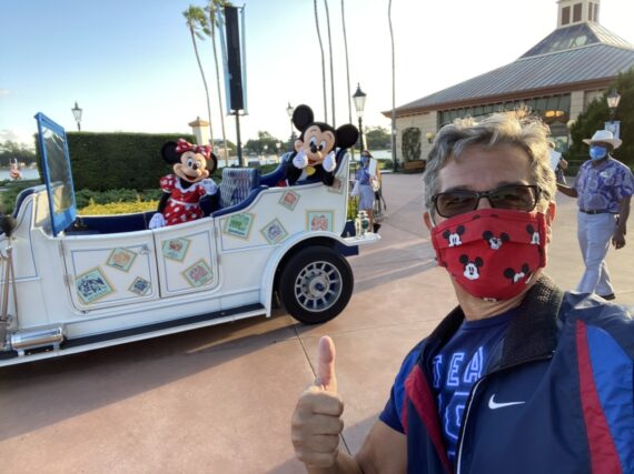 jeff noel with Mickey and Minnie riding in a parade car at Epcot