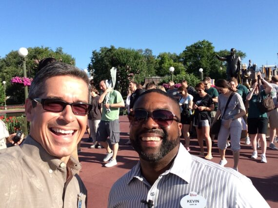 Two smiling Disney institute cast members
