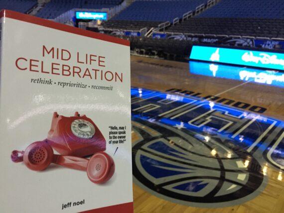 The book Mid Life Celebration Centercourt at the Orlando Magic arena