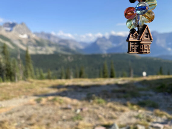 Small house toy with beads in mountains