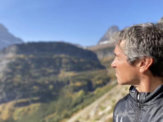man staring out at mountains