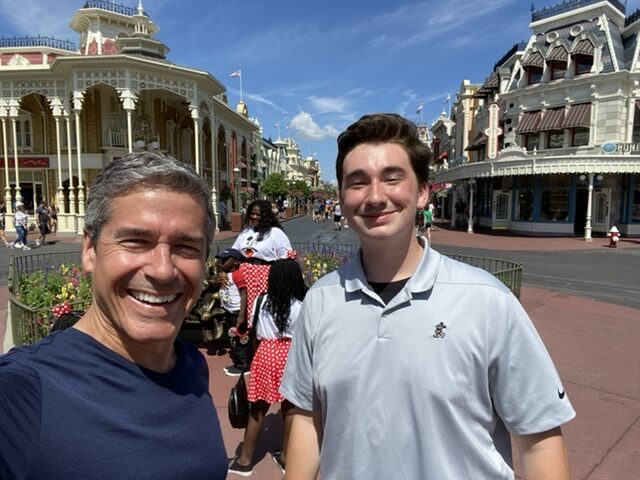 retired man and college student in Magic Kingdom