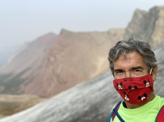 masked man in mountains