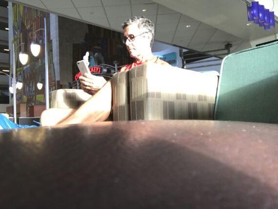 man on iPhone at Disney Resort