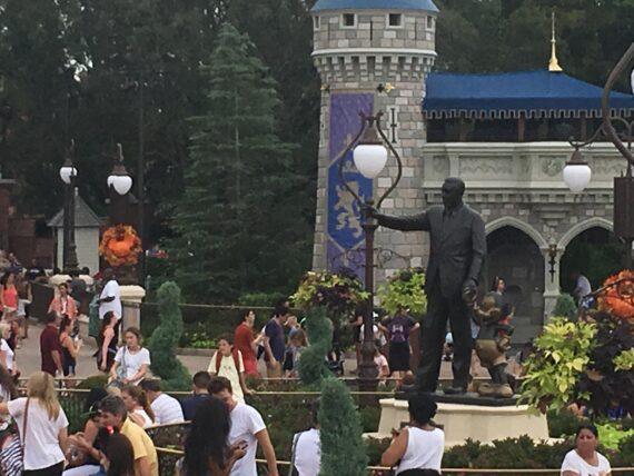 Magic Kingdom Partners statue from double-decker bus