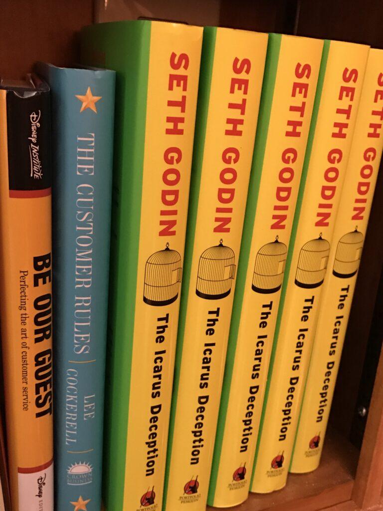 bookshelf with Seth Godin and Disney books