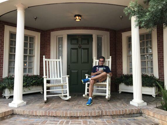 disney speaker Jeff Noel sitting on Magic Kingdom rocking chair