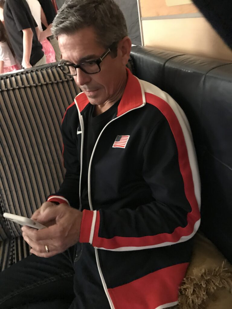 Disney business author Jeff Noel writing on an iPhone