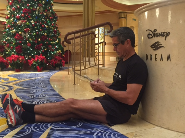 Disney brand loyalty author Jeff Noel writing on iPhone