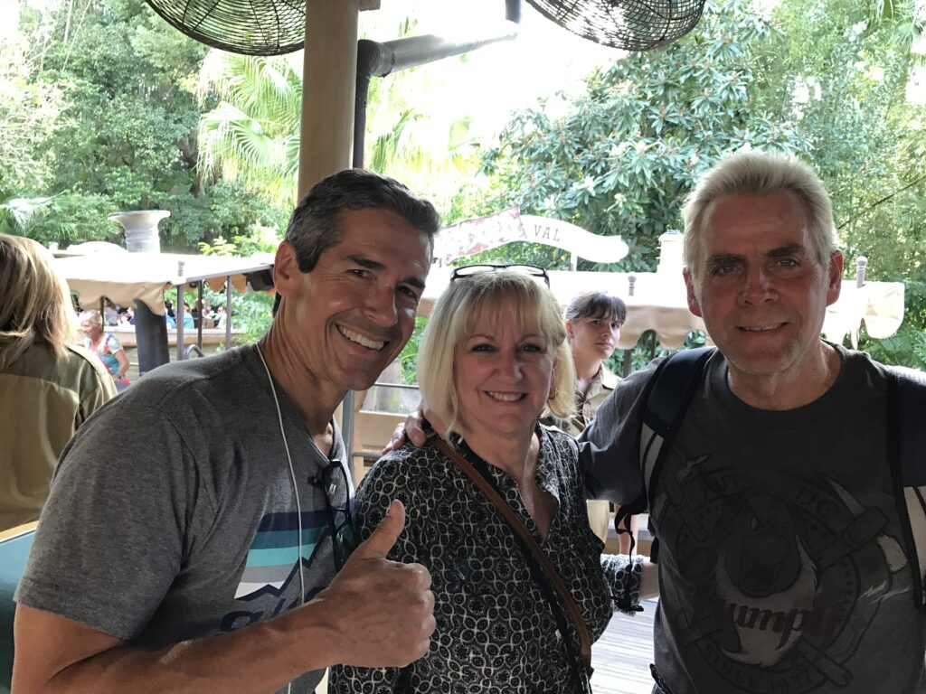 three adults at Disney's Jungle Cruise Attraction