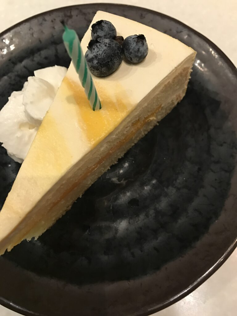 cheesecake slice with a hidden Mickey made from three blueberries