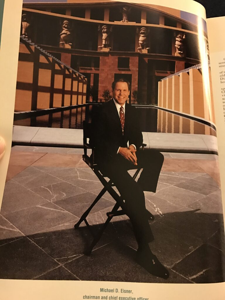 Michael Eisner sitting on a director's chair