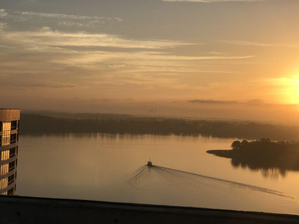 boat on quiet lake at sunrise