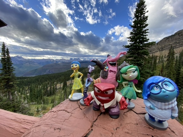 Disney toy figurines in the mountains